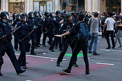A demonstrator is carried through smoke caused by a flash-bang grenade during a protest in Washington, D.C., U.S., on Sunday, May 31, 2020, following the death of an unarmed black man at the hands of Minnesota police. 31 May 2020 Pictured: Protestors clash with police officers in Washington, D.C., U.S., on Sunday, May 31, 2020, following the death of an unarmed black man at the hands of Minnesota police on May 25, 2020. Credit: Stefani Reynolds / CNP. Photo credit: Stefani Reynolds - CNP / MEGA TheMegaAgency.com +1 888 505 6342