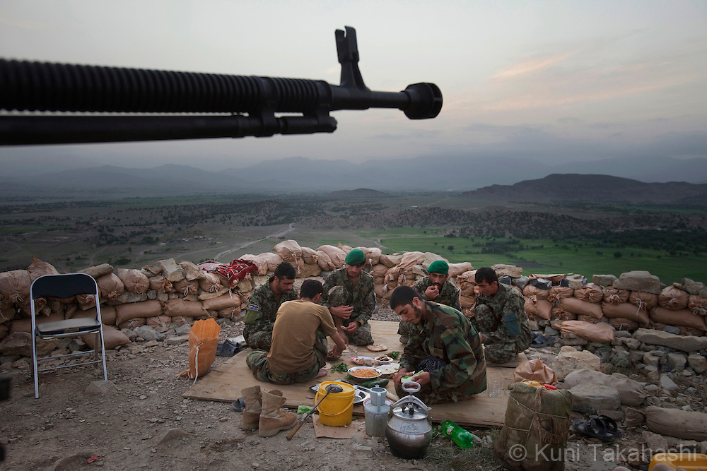 Afghan National Army soldiers eat dinner as they break fast during holy month of Ramadan at an outpost in Sabari district of Khost, eastern Afghanistan on Aug 9, 2011.(Photo by Kuni Takahashi)