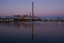 Stock photo of a chemical plant reflected in a pool at dusk