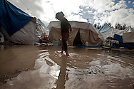 Rita wades through the flooded refugee camp to get to her tent. Yayladagi refugee camp for Syrians in southern Turkey. 12/21/2012 Bradley Secker for the Washington Post