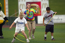 09 June 2011:  Two youngsters perform with hula hoops during a game between the Lake Erie Crushers and the Normal Cornbelters at the Corn Crib in Normal Illinois.