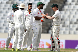 August 29, 2017 - Mirpur, Dhaka, Bangladesh - Bangladesh's Tamim Iqbal, center, tries to break an argument between Australia's David Warner, right, and Bangladesh's Sabbir Rahman during day three of the First Test match between Bangladesh and Australia at Shere Bangla National Stadium on August 29, 2017 in Mirpur, Bangladesh. (Credit Image: © Ahmed Salahuddin/NurPhoto via ZUMA Press)