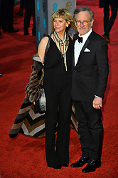 © Licensed to London News Pictures. 14/02/2016.  London, UK. STEPHEN SPEILBERG and KATE CAPSHAW arrives on the red carpet at the EE British Academy Film Awards 2016  Photo credit: Ray Tang/LNP
