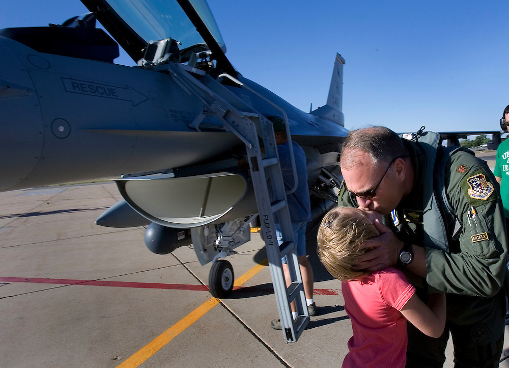 Caption Only: Here Major Terry George gives his daughter Hailee (name spelling cq) a kiss goodbye as he and Col. Andrew Larson and Major Eric Mulert prepare to take off in the last three F-16's from the 419th as the 419th Fighter Wing at Hill AFB says goodbye to its final three F-16 aircraft as they depart for reassignment to other Air Reserve and Air National Guard bases. This is part of an Air Force initiative which aims to increase combat capabilities and efficiencies among like units while capitalizing on the high experience levels of Air Force Reserve and Air National Guard personnel. Who will join their counterparts in Hill's active duty 388th Fighter Wing to carry out the flying mission. Photo taken Thursday, June 28, 2007.  August Miller/ Deseret Morning News