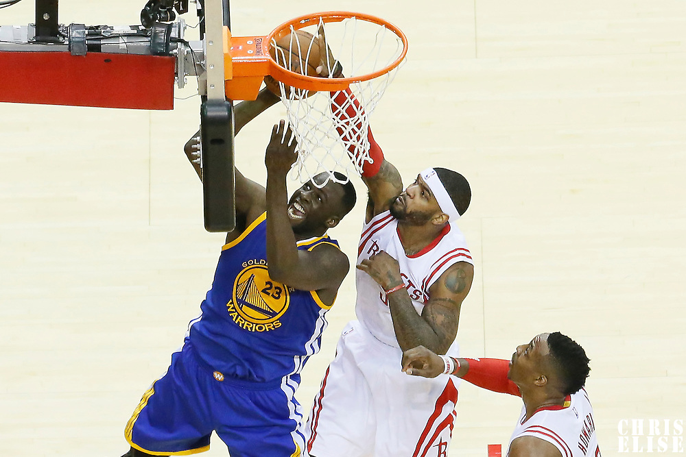 23 May 2015: Golden State Warriors forward Draymond Green (23) is blocked by Houston Rockets forward Josh Smith (5) during the Golden State Warriors 115-80 victory over the Houston Rockets, in game 3 of the Western Conference finals, at the Toyota Center, Houston, Texas, USA.