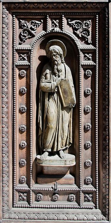 Bronze relief statue in the door of a church in the Mergellina area of Naples.