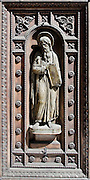 Bronze relief statue in the door of a church in the Mergellina area of Naples.