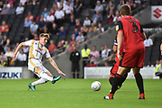 Milton Keynes Dons midfielder Ryan Watson (7) takes a shot at goal during the EFL Sky Bet League 2 match between Milton Keynes Dons and Grimsby Town FC at stadium:mk, Milton Keynes, England on 21 August 2018.