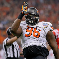 Jan 1, 2016; New Orleans, LA, USA; Oklahoma State Cowboys defensive tackle Vincent Taylor (96) celebrates after a sack on Mississippi Rebels quarterback Chad Kelly (not pictured) during the first quarter in the 2016 Sugar Bowl at the Mercedes-Benz Superdome. Mandatory Credit: Derick E. Hingle-USA TODAY Sports