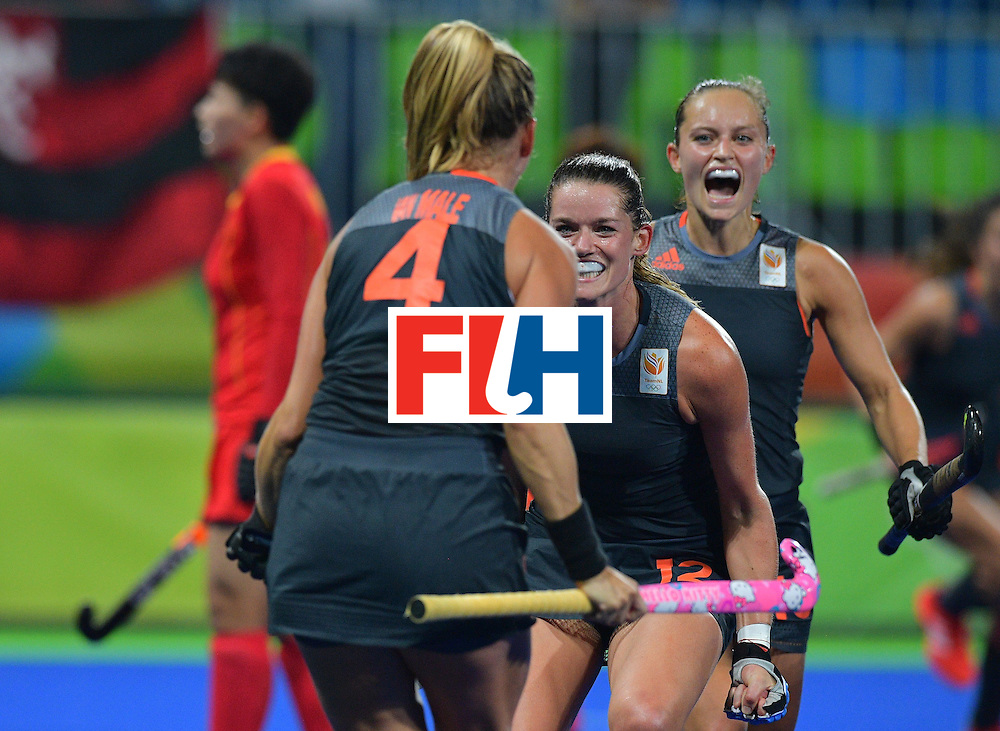 Netherland's Lidewij Welten (C) celebrates a goal scored by Netherland's Kitty van Male (L) during the women's field hockey China vs Netherlands match of the Rio 2016 Olympics Games at the Olympic Hockey Centre in Rio de Janeiro on August, 10 2016. / AFP / Carl DE SOUZA        (Photo credit should read CARL DE SOUZA/AFP/Getty Images)
