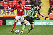 Charlton Athletic Forward Leon Best (8) and Plymouth Argyle Midfielder Jamie Ness (6) battle for the ball during the EFL Sky Bet League 1 match between Charlton Athletic and Plymouth Argyle at The Valley, London, England on 24 March 2018. Picture by Stephen Wright.