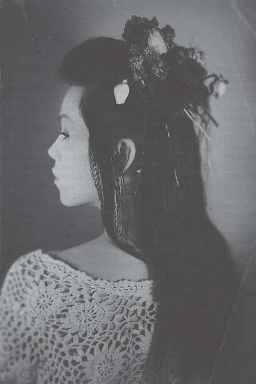 Dark haired young woman in profile with back to camera