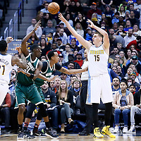 03 February 2016:Denver Nuggets forward Nikola Jokic (15) passes the ball to Denver Nuggets forward Wilson Chandler (21) over Milwaukee Bucks guard Tony Snell (21)  during the Denver Nuggets 121-117 victory over the Milwaukee Bucks, at the Pepsi Center, Denver, Colorado, USA.