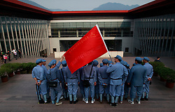 Chinese communist party course trainees dressed in Red Army uniforms pose for photos in a group at the Jinggangshan Revolutionary Museum in Jinggangshan of Jiangxi Province, China, 14 October 2012. Jinggangshan or Jinggang mountain is a popular destination for Red Tourism where Chinese communist party cadres and ordinary Chinese tourists alike converge, seeking to relive the experiences and rekindle the spirit of the revolutionaries. It is deemed as the birthplace of the Chinese Red Army and the 'cradle of the Chinese revolution' which saw Communist leader Mao Zedong's ascent to power as a revolutionary. After a failed uprising in 1927, Mao fled into the mountains with his 1,000 remaining troops from nationalist forces and set up base here to reorganize his army, eventually defeating the Kuomingtang (KMT) to rule the country. Cadres dressed in Red Army uniforms attending Communist party training courses in are a common sight in the various historical sites of the mountain where they sing red songs and retrace the paths taken by their forbears. The Chinese communist party is slated to hold its 18th national congress on 08 November where a major leadership transition will see current leaders President Hu Jintao and Premier Wen Jiabao make way for a new generation of leaders helmed by Xi Jinping, With more than 80 million members, the Chinese Communist Party is hard pressed to display a show of unity and power after  scandals the ousting of disgraced politician Bo Xilai roiled the country. .
