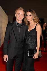 TOM FELTON and JADE OLIVIA at the IWC Schaffhausen Gala Dinner in honour of the British Film Institute held at the Battersea Evolution, Battersea Park, London on 7th October 2014.