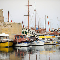 Girne, (Kyrenia) North Cyprus 19 April 2008<br /> View of the old harbour of Girne.<br /> The Turkic Republic of Northern Cyprus (TRNC), commonly called Northern Cyprus, is a de facto independent republic located in the north of Cyprus. The TRNC declared its independence in 1983, nine years after a Greek Cypriot coup attempting to annex the island to Greece triggered an invasion by Turkey. It has received diplomatic recognition only from Turkey, on which it has become dependent for economic, political and military support. The rest of the international community, including the United Nations and European Union, recognises the sovereignty of the Republic of Cyprus over the territory of the TRNC.<br /> Photo: Ezequiel Scagnetti