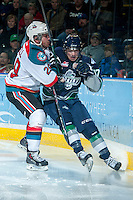 KELOWNA, CANADA -FEBRUARY 10: Myles Bell #29 of the Kelowna Rockets checks Shea Theodore #17 of the Seattle Thunderbirds into the boards during first period on February 10, 2014 at Prospera Place in Kelowna, British Columbia, Canada.   (Photo by Marissa Baecker/Getty Images)  *** Local Caption *** Myles Bell; Shea Theodore;