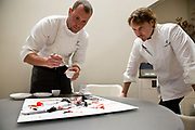 Executive chef Mike Bagale and chef Grant Achatz, workout the placement of a dish containing duck, huitlecoche, strawberry and white corn on an acrylic art piece designed to be eaten off of at Alinea, an upscale restaurant which underwent a total gut renovation in the Lincoln Park neighborhood of Chicago, Ill., on Thursday, April 28, 2016. Nathan Weber for the New York Times