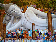 17 JULY 2017 - INTHA PRAMUN, ANG THONG, THAILAND: A mural of people around the reclining Buddha at Wat Khun Inthapramun. Wat Khun Inthapramun houses the largest and longest reclining Buddha in Thailand. The statue of the reclining Buddha is more than 50 meters long. The temple is located in the middle of rice fields, in the southern part of the Pho Thong district. The temple was built during the Sukhothai era, is revered in Thai history and late King Bhumibol Adulyadej (Rama IX) visited twice, in 1973 and 1975.    PHOTO BY JACK KURTZ