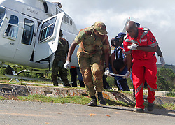 Members of the army and Red Cross carry a patient to a temporary treatment centre after being rescued. Five days after tropical cyclone Idai cut a swathe through Mozambique, Zimbabwe and Malawi, the confirmed death toll stood at more than 300 and hundreds of thousands of lives were at risk, officials said.