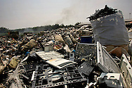 Heaps of electronic lie at a dumping site in an area where much of the world's electronic waste _ from cell phone chargers to mainframe computers _ ends up in Guiyu and other small towns like it in eastern China, Thursday March 16, 2006. Workers, many of them poorly paid migrants strip, smash and melt down circuit boards, mainly to extract the copper and other precious metals inside. The business has created massive pollution from leaded glass and other toxic materials. A water sample taken from the site revealed lead levels 2,400 times higher than the World Health Organization's limit for drinking water.