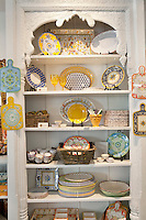 Variety of kitchenware arranged on shelf