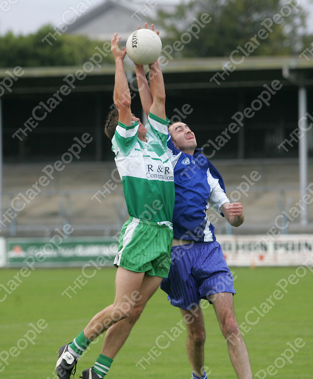 Kilballyowens Seamus Madigan battles for possession with Wolfe Tones Brian O Conmnell in the Auburn Lodge Clare senior football championship round four played at Cusack Park. Pic Sean Curtin Press 22.
