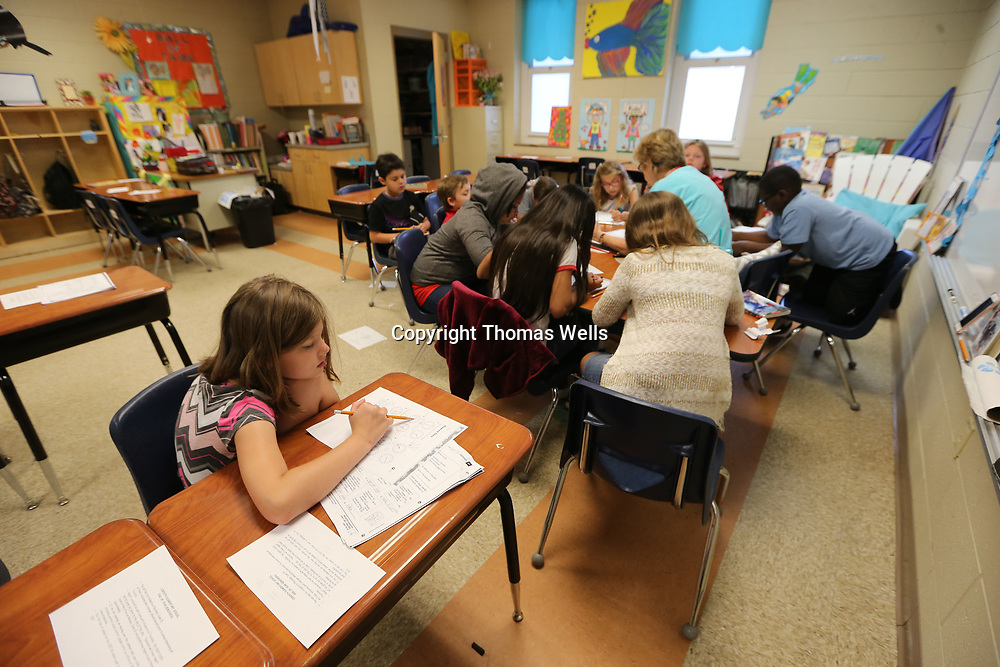 """Sadie Smith works on some """"ctime reading"""" charts during her last day of school on Thursday."""