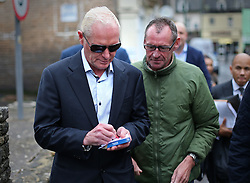 © Licensed to London News Pictures. 29/10/2015. Bournemouth, UK. Paul Gascoigne signs an autograph during a break outside Bournemouth Magistrates Court after pleading guilty to harassment and assault charges. Photo credit: Peter Macdiarmid/LNP