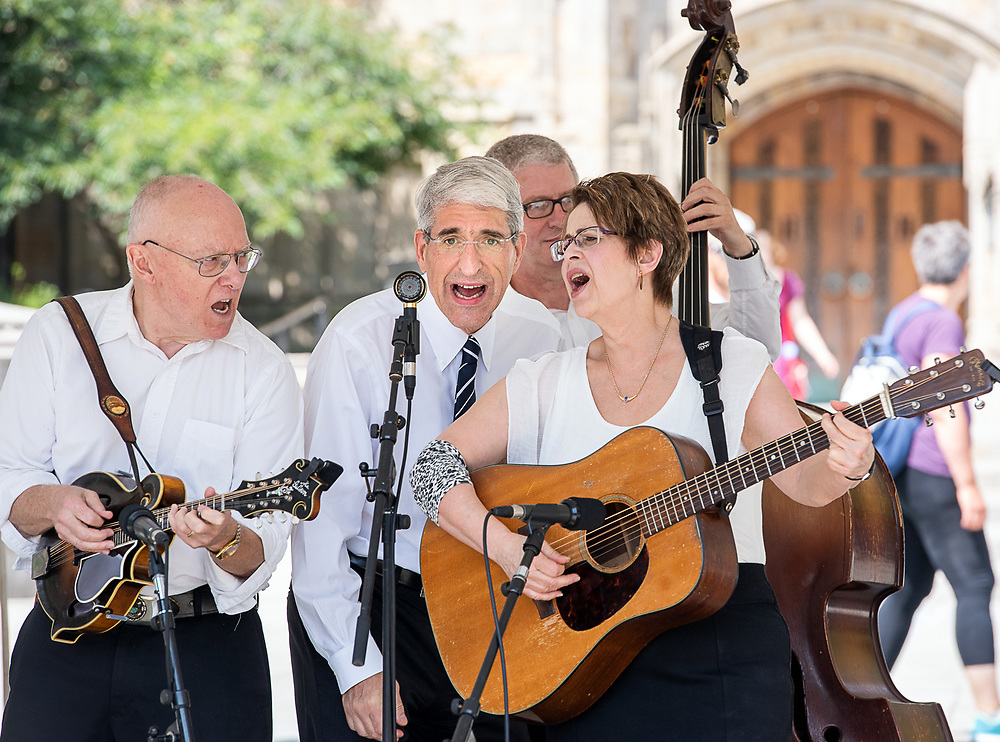 Photography ©Mara Lavitt<br /> August 25, 2018<br /> <br /> Yale College Class of 2022 Opening Assembly in Woolsey Hall and reception on Cross Campus. President Peter Salovey sang one nunber with a blue grass band entertaining on Cross Campus.