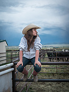 A cowhand pauses to take in the day's last light at the 2017 Sangre de Cristo Summer Classic cutting horse competition in Westcliffe, CO.