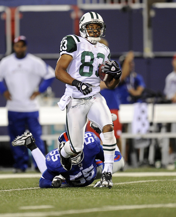 EAST RUTHERFORD, NJ - AUGUST 29: Chansi Stuckey #83 of the New York Jets runs with the ball against the New York Giants in a preseason game at Giants Stadium on August 29, 2009 in East Rutherford, New Jersey. The New York Jets beat the New York Giants 27-25. (Photo by Rob Tringali) *** Local Caption *** Chansi Stuckey