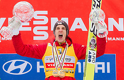 Overall World Cup winner Gregor Schlierenzauer of Austria celebrates during trophy ceremony after the Flying Hill Individual Event at 4th day of FIS Ski Jumping World Cup Finals Planica 2013, on March 24, 2013, in Planica, Slovenia. (Photo by Vid Ponikvar / Sportida.com)