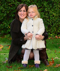 Natalie Cassidy, is joined by daughter Eliza to launch this year's Santa experience at London Zoo. The pair have a festive day at the zoo, posing for pictures with a reindeer before meeting Father Christmas in his grotto, London, United Kingdom. Wednesday, 13th November 2013. Picture by Nils Jorgensen / i-Images