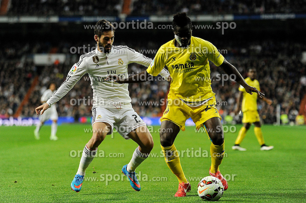 01.03.2015, Estadio Santiago Bernabeu, Madrid, ESP, Primera Division, Real Madrid vs FC Villarreal, 25. Runde, im Bild Real Madrid&acute;s Isco and Villarreal CF&acute;s Eric Bailly // during the Spanish Primera Division 25th round match between Real Madrid CF and Villarreal at the Estadio Santiago Bernabeu in Madrid, Spain on 2015/03/01. EXPA Pictures &copy; 2015, PhotoCredit: EXPA/ Alterphotos/ Luis Fernandez<br /> <br /> *****ATTENTION - OUT of ESP, SUI*****