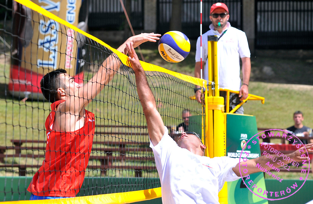 Special Olympics athletes while training session match of Special Olympics Poland during Day 7 of the FIVB World Championships on July 7, 2013 in Stare Jablonki, Poland. <br /> <br /> Poland, Stare Jablonki, July 07, 2013<br /> <br /> Picture also available in RAW (NEF) or TIFF format on special request.<br /> <br /> For editorial use only. Any commercial or promotional use requires permission.<br /> <br /> Mandatory credit:<br /> Photo by &copy; Adam Nurkiewicz / Mediasport