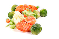 Frozen vegetables on white background