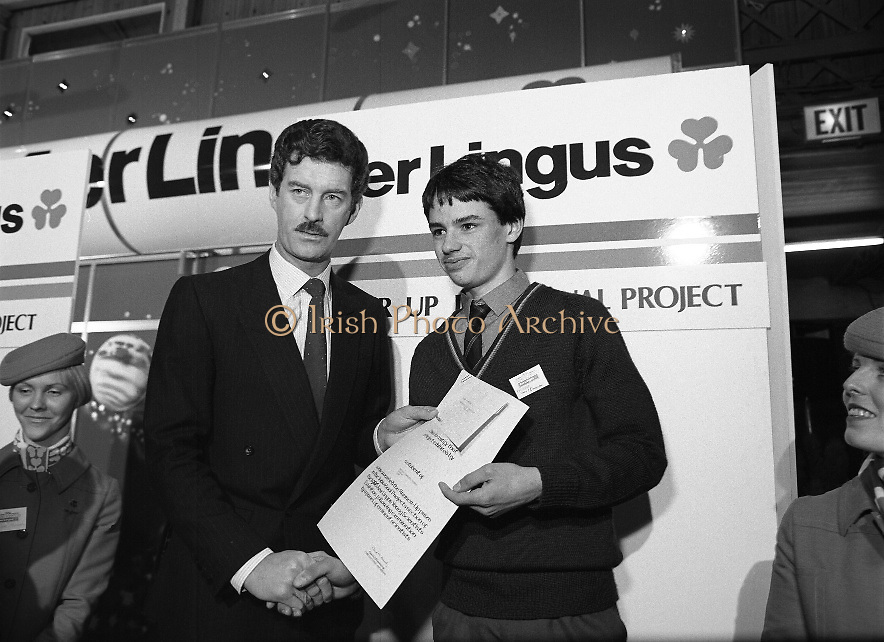"Aer Lingus Young Scientist Exhibition..1986..10.01.1986..01.10.1986..10th January 1986..The annual Aer Lingus,sponsored,Young Scientists Exhibition was held at the RDS,Ballsbridge,Dublin.The Overall winners of the competition were Ms Breda Maguire and Ms Niamh Mulvany..They are students at The Rosary College,Raheny,Dublin. The Tanaiste, Mr Dick Spring TD was on hand to present the awards...Photograph of Shane Donovan,.Silverdale Road,Ballinlough,Cork being awarded the Runner-up Individual Award By Tanaiste Mr Dick Spring. Shane submitted a project called ""The quality of water in the aquifiers of the Cork regionwith reference to industrial development"". Thisis Shane's third entry into the competition. Last year Shane won the ""Chemistry Association Of Ireland Award""..This year as part of his prize,Shane, will be invited to attend the European Space Agency Base on the occasion of the space craft ""Giotto"" meeting ""Halleys Comet""."