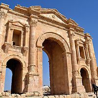 Arch of Hadrian in Ancient Jerash, Jordan<br /> Jerash, originally called Gerasa, was a major city in Jordan. Some believe it was founded by Alexander the Great in 331 BC or at least began to grow significantly in the early 4th century.  Hadrian&rsquo;s Arch is the spectacular entrance. Historically, commoners walked through one side while the other arch was reserved for nobles. Regardless of how you pass through, you will immediately feel the grandeur of ancient Roman times. The streets are lined with endless columns. Also impressive are two amphitheaters, a forum, a hippodrome and temples.