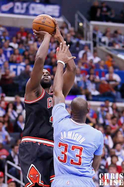 24 November 2013: Chicago Bulls center Nazr Mohammed (48) takes a jumpshot over Los Angeles Clippers power forward Antawn Jamison (33) during the Los Angeles Clippers 121-82 victory over the Chicago Bulls at the Staples Center, Los Angeles, California, USA.