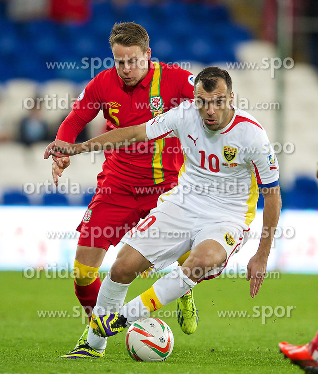 11.10.2013, City Stadion, Cardiff, WAL, FIFA WM Qualifikation, Wales vs Mazedonien, Gruppe A, im Bild Wales' Chris Gunter in action against Macedonia's captain Goran Pandev during the FIFA World Cup Qualifier Group A Match between Wales and Macedonia at the City Stadium, Cardiff, Wales on 2013/10/11. EXPA Pictures © 2013, PhotoCredit: EXPA/ Propagandaphoto/ David Rawcliffe<br /> <br /> ***** ATTENTION - OUT OF ENG, GBR, UK *****