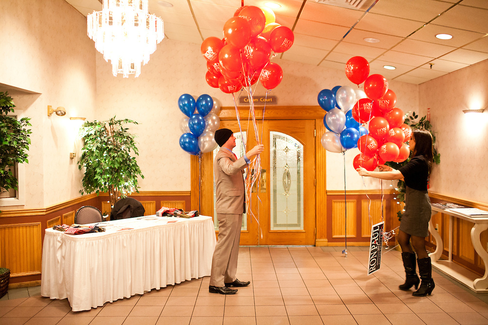 Chris Gosselin, a volunteer for the campaign of Republican presidential candidate Ron Paul, left, and Allison Gibbs, an advance staffer, prep balloons for a primary night rally at the Executive Court banquet facility on Tuesday, January 10, 2012 in Manchester, NH. Brendan Hoffman for the New York Times