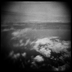 Textured image of a cloudy sky seen from an airplane