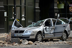 High Holborn Building Collapse. A woman was killed and a man was injured when a building collapsed on her car at Holborn Tube station on Friday night. High Holborn, London, United Kingdom. Saturday, 15th February 2014. Picture by Peter Kollanyi / i-Images