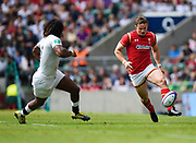 Wales' Hallam Amos kicks the ball through past England's Marland Yarde during the The Old Mutual Wealth Cup match England -V- Wales at Twickenham Stadium, London, Greater London, England on Sunday, May 29, 2016. (Steve Flynn/Image of Sport)