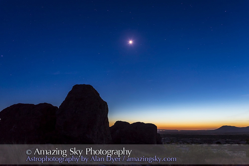 The waxing crescent Moon with Earthshine, in the deep twilight sky, May 2, 2014, with Orion and the winter stars setting over the City of Rocks State Park, south of Silver City, New Mexico. This is a single 5 second exposure at f/4 and ISO 400 with the Canon 6D and 24mm lens. Taken as part of a 150-frame sunset to twilight time-lapse.