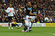 Derby defender Richard Keogh blocks Bolton forward Kaiyne Woolery's attempt at goal during the Sky Bet Championship match between Derby County and Bolton Wanderers at the iPro Stadium, Derby, England on 9 April 2016. Photo by Aaron  Lupton.