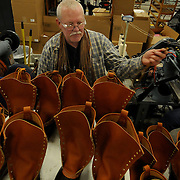 "1/17/12 -- BRUNSWICK, Maine. Terry Amsted of Brunswick works in the L.L.Bean manufacturing facility in Brunswick on Tuesday after ceremonies to kick off the 100th birthday began with the unveiling of the Bootmobile. .Among other, company CEO Chris McCormick came on Tuesday to kick off the 100th anniversary celebrations -- and break in the size 747 boot for it's cross-country trip. The Bootmobile, a size 747 replica of the Maine Hunting Shoe, is made from fiberglass and mounted on top of a biodiesel-fueled truck. The plan is to drive it to New York and other places in the US to celebrate L.L.Bean's 100th year in business. The tour started Tuesday at the Brunswick Manufacturing facility where boots, bags, bikes and skis are assembled. McCormick said with a laugh,""Ooh, I'm not driving it. Imagine the headlines - CEO crashes Bootmobile."" The bootmobile is piloted by Ian Bechtel of Portland Ore, a professional driver and tour operator. Photo by Roger S. Duncan. .."