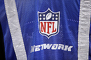A sideline cameraman wears a vest with the NFL Network logo on it during the Philadelphia Eagles NFL week 3 football game against the Kansas City Chiefs on Thursday, Sept. 19, 2013 in Philadelphia. The Chiefs won the game 26-16. ©Paul Anthony Spinelli