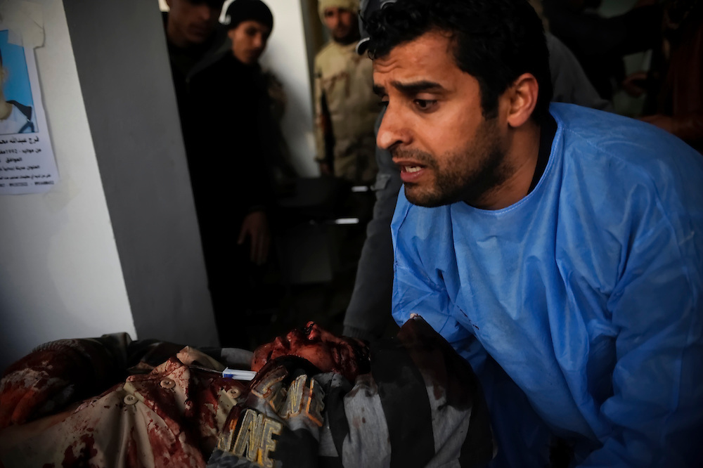 Medics tend to an Injured rebel fighter  at the Ras Lanuf hospital after taking heavy gun fire and artillery shelling during an air strike on Wednesday, March 9, 2011  while advancing between the oil port of Ras Lanuf and Bin Jiwad, Libya.  Medics working with opposition forces in eastern Libya are reporting over 400 rebels have been killed by pro-Qaddafi forces in the region since the uprise began.